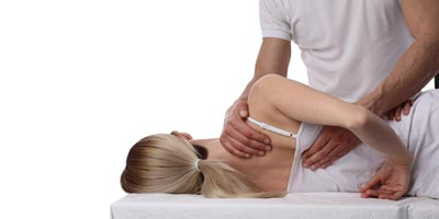Osteopathy Button Woman having treatment